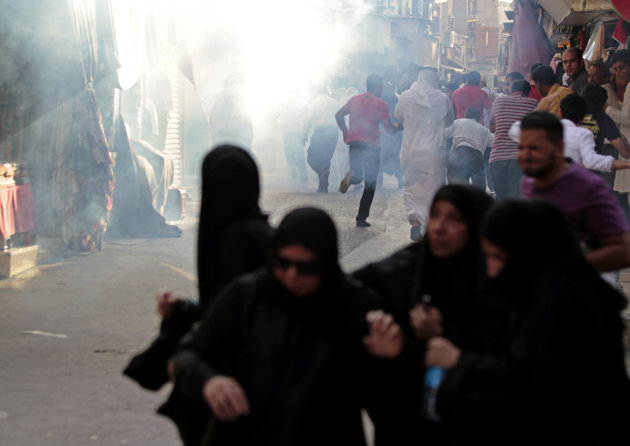 Bahraini anti-government protesters run from tear gas fired by riot police in the heart of the Gulf's kingdom's capital Manama, Bahrain, Sept. 7, 2012. The demonstrations by Shiite-led groups Friday are part of attempts to challenge authorities by reviving opposition marches in the commercial center of the strategic nation, which is home to the U.S. Navy's 5th Fleet. (AP Photo/Hasan Jamali)
