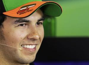 Force India Formula One driver Perez of Mexico smiles during a news conference at the Hungaroring circuit, near Budapest