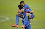 Levante's Valdo Lopes (R) celebrates with teammate Botelho after scoring during their Spanish La Liga match against Granada, on April 28, at Ciutat de Valencia stadium in Valencia. Levante won 3-1