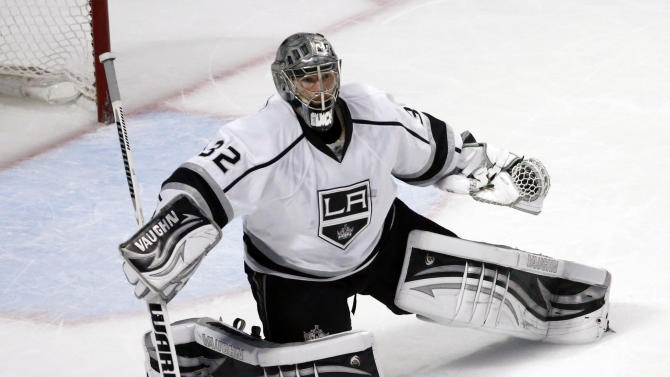 Los Angeles Kings goalie Jonathan Quick (32) turns away the puck during the first period in Game 5 of the NHL hockey Stanley Cup playoffs Western Conference finals against the Chicago Blackhawks Saturday, June 8, 2013, in Chicago. (AP Photo/Charles Rex Arbogast)
