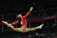US gymnast Gabrielle Douglas performs on the beam during the women's team final of the artistic gymnastics event of the London Olympic Games at the 02 North Greenwich Arena in London. USA won gold