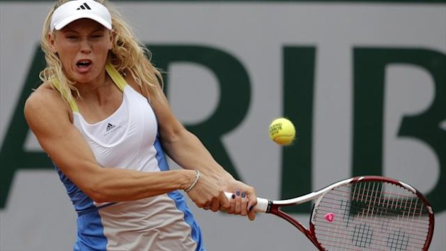 Denmark's Caroline Wozniacki returns the ball to Britain's Laura Robson during their first round match of the French Open tennis tournament at the Roland Garros stadium Monday, May 27, 2013 in Paris.