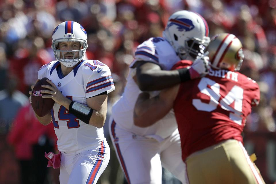 Buffalo Bills quarterback Ryan Fitzpatrick (14) looks to pass against the San Francisco 49ers during the first quarter of an NFL football game, Sunday, Oct. 7, 2012, in San Francisco. (AP Photo/Tony Avelar)