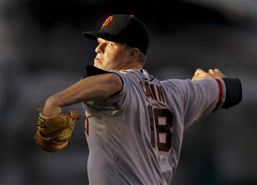 Cain gets imperfect win for Giants over Angels
