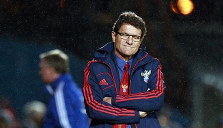 Russia's manager Fabio Capello reacts after they were beaten by Northern Ireland in their World Cup qualifying soccer match at Windsor Park Stadium in Belfast