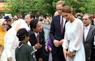 "<p>Prince William and his wife Catherine, the Duchess of Cambridge, meet with students while walking in the gardens of the KLCC in Kuala Lumpur on September 14. The British royal family have warned an Italian magazine that ""unjustifiable upset"" would be heaped on Catherine if it went ahead and printed topless photos of her.</p>"