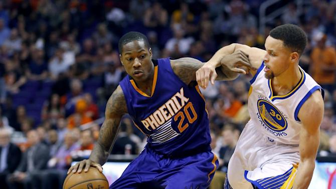 Phoenix Suns' Archie Goodwin (20) drives next to Golden State Warriors' Stephen Curry (30) during the second half of an NBA basketball game, Wednesday, Feb. 10, 2016, in Phoenix. (AP Photo/Matt York)