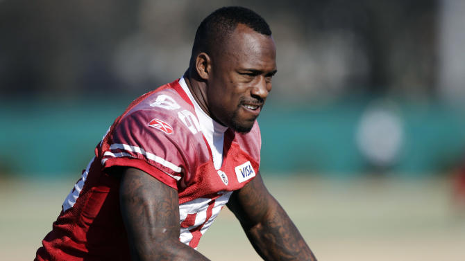 San Francisco 49ers tight end Vernon Davis (85) stretches during NFL football practice in Santa Clara, Calif., Wednesday, Jan. 11, 2012, in preparation for the 49ers' playoff game against the New Orleans Saints on Saturday, Jan. 14. (AP Photo/Paul Sakuma)