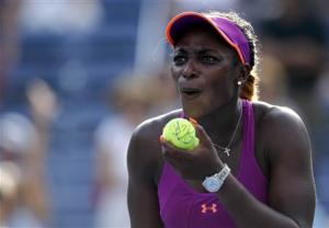 Stephens of the U.S. reacts after hitting a ball into the crowd after her win over compatriot Hampton at the U.S. Open tennis championships in New York