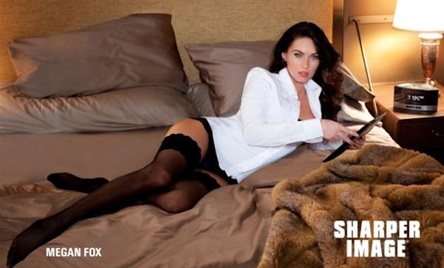 Sexy celebrity ad campaigns: Megan Fox has tipped the scales of sexiness once more as she slipped into stockings for electronics company, Sharper Image. The actress donned black hold ups and a white s