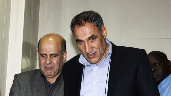 FILE - In this Monday, June 25, 2012 file photo, Iranian nationals Ahmad Abolfathi Mohammad, left, and Sayed Mansour Mousavi arrive in court in Nairobi, Kenya, where they faced charges related to the possession of explosives. On Monday, July 2, 2012, officials told The Associated Press that Mousavi and Mohammad, who led authorities to a cache of explosives after their arrest, planned to attack Israeli, U.S., British or Saudi targets inside Kenya. (AP Photo/Khalil Senosi, File)
