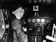 <p>American aviator Amelia Earhart sits at the controls of her plane in the 1930s. Researchers trying to unravel the mystery surrounding the 1937 disappearance of Earhart in the Pacific have said they spotted debris under water that may have come from her plane.</p>