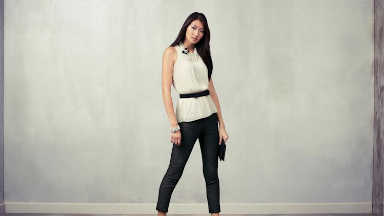 This undated product image released by Ann Taylor shows a model wearing a white sleeveless blouse and black cigarette pants. (AP Photo/Ann Taylor)