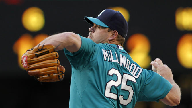 Seattle Mariners starting pitcher Kevin Millwood throws against the Los Angeles Dodgers in the first inning of a baseball game Friday, June 8, 2012, in Seattle.The Mariners won 1-0 in a six-pitcher combined no-hitter. (AP Photo/Elaine Thompson)