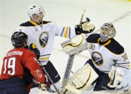Buffalo Sabres goalie Ryan Miller (30) watches as teammate Jordan Leopold (3) reaches for the puck in front of Washington Capitals center Nicklas Backstrom (19), of Sweden, during the second period of an NHL hockey game, Friday, Dec. 30, 2011, in Washington. (AP Photo/Nick Wass)