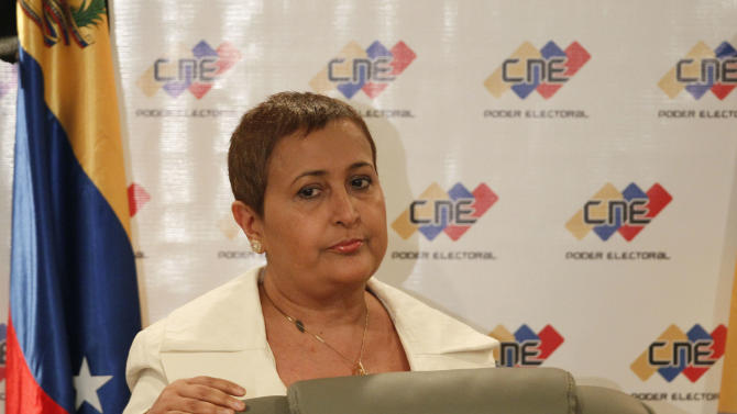 Venezuela's elections council chief, Tibisay Lucena, arrives for a press conference to announce April 14 as the date for the country's presidential election to choose a successor to Hugo Chavez, in Caracas, Venezuela, Saturday, March 9, 2013. The constitution mandated the election be held within 30 days of Chavez's March 5 death, but the date picked falls outside that period. Critics of the socialist government already complained that officials violated the constitution by swearing in Vice President Nicolas Maduro as acting leader Friday night. (AP Photo/Ariana Cubillos)