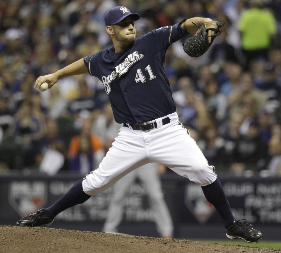 Milwaukee Brewers relief pitcher Marco Estrada throws during the fifth inning of Game 2 of baseball's National League championship series against the St. Louis Cardinals Monday, Oct. 10, 2011, in Milwaukee. (AP Photo/Matt Slocum)