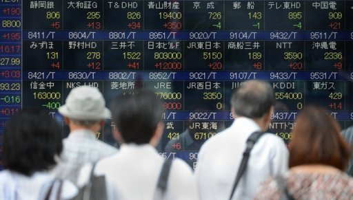 &lt;p&gt;An electronic stock prices display at the Tokyo Stock Exchange. Asian stock markets were mixed Tuesday but Tokyo closed lower after the Bank of Japan announced monetary easing that was only slightly bigger than market forecasts and cut its growth outlook.&lt;/p&gt;