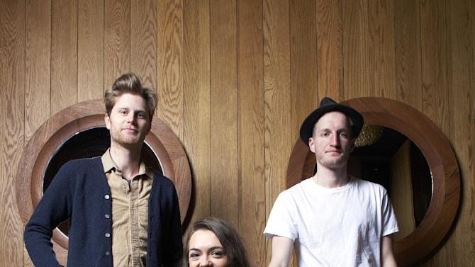This Jan. 18, 2013 photo shows members of the American folk rock band The Lumineers, from left, Wesley Schultz, Neyla Pekarek and Jeremiah Fraites at the Dream Downtown Hotel in New York. The band is nominated for two Grammy Awards, including best new artist.  The Grammys will be held on Feb. 10.  (Photo by Dan Hallman/Invision/AP)
