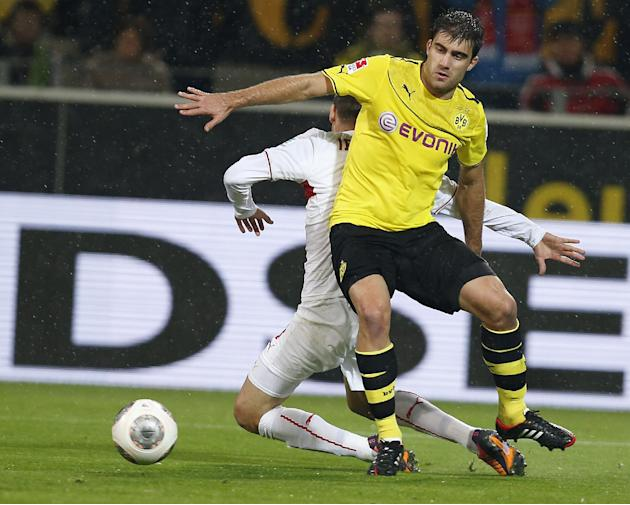 Stuttgart's Vedad Ibisevic of Bosnia, rear, and Dortmund's Sokratis of Greece challenge for the ball during the German first division Bundesliga soccer match between  BvB Borussia Dortmund and VfB Stu