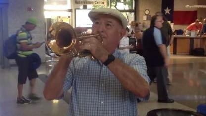 Husband Plays the Trumpet to Greet His Wife of 33 Years at the Airport
