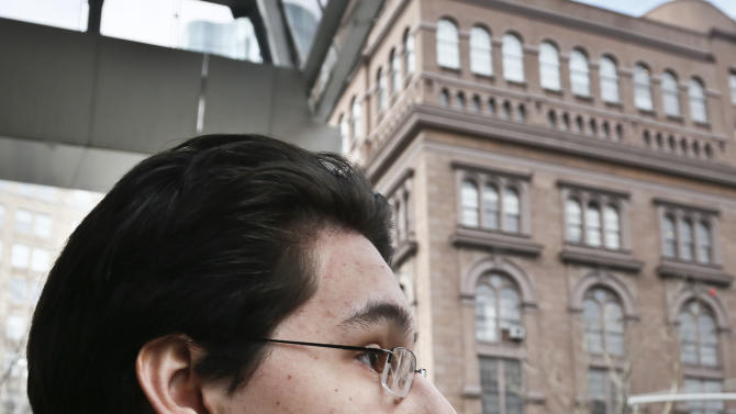 In this Friday, Feb. 22, 2013 photo, Diego Gonzalez, 19, an architecture sophomore and student council member at Cooper Union, listens during an interview outside the university in New York. The Board of Trustees at the Cooper Union, which has been tuition free for 110 years, is expected to vote in March in favor of a proposal to charge its undergraduates something _ anything _ for their education. (AP Photo/Bebeto Matthews)
