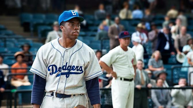 """This film image released by Warner Bros. Pictures shows Chadwick Boseman as Jackie Robinson in a scene from """"42.""""  The movie,  about Robinson's, life, is bringing his inspiring story to a new generation. Fans young and old can find a number of places in Brooklyn connected to the baseball great. (AP Photo/Warner Bros. Pictures, D. Stevens)"""