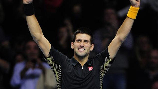 Novak Djokovic celebrates beating Tomas Berdych during their Group A singles match in the round robin stage on the fifth day of the ATP World Tour Finals tennis tournament in London (AFP)