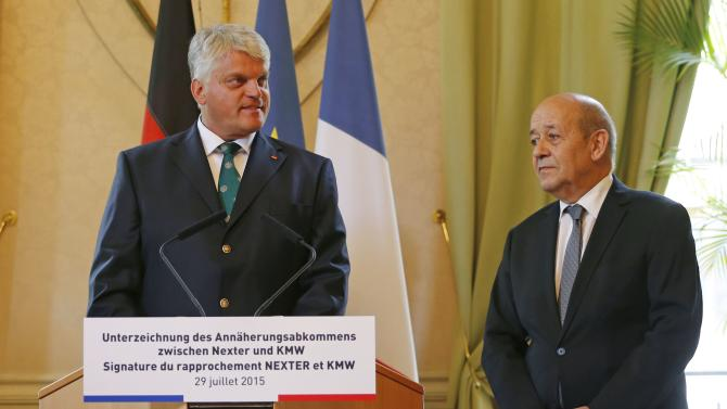 German Junior Defence Minister Grubel delivers a speech near French Defence Minister Le Drian at the French Defence Ministry in Paris