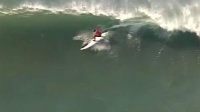 Surfers battle frigid waters in big wave contest