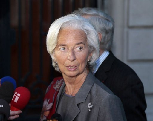 "Head of the International Monetary Fund (IMF) France's Christine Lagarde speaks to the press as she leaves the French Republic Justice Court on May 24, 2013 in Paris. Lagarde avoided immediate charges but was named an ""assisted witness"" after French prosecutors grilled her for two days over a state payout to a disgraced tycoon when she was finance minister."