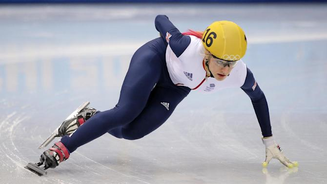 Elise Christie of Britain competes in a women's 1000m short track speedskating heat at the Iceberg Skating Palace during the 2014 Winter Olympics, Tuesday, Feb. 18, 2014, in Sochi, Russia