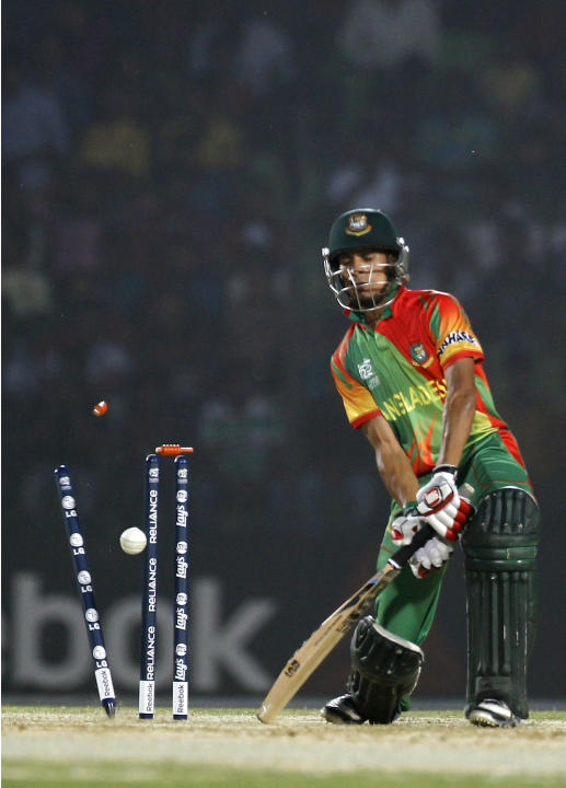 The bails fly off the wickets to dismiss Bangladeshi cricketer Nasir Hossain during a warm-up cricket match against United Arab Emirates ahead of the Twenty20 World Cup Cricket in Fatullah, near Dhaka