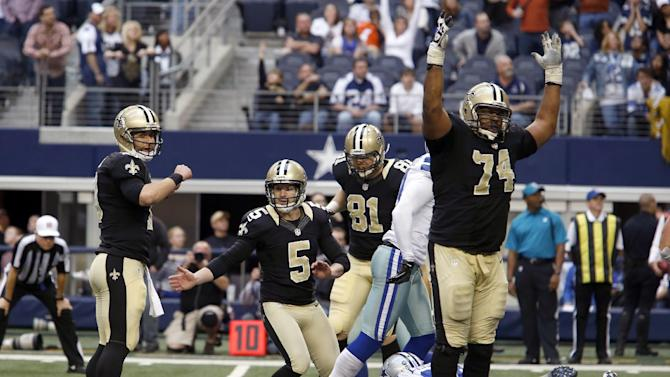 After making a field goal to win the game, New Orleans Saints kicker Garrett Hartley (5) joins teammates Chase Daniel (10), Mike Higgins (81) and Jermon Bushrod (74) in celebration during overtime play at an NFL football game against the Dallas Cowboys, Sunday, Dec. 23, 2012, in Arlington, Texas. The Saints won 34-31. (AP Photo/Sharon Ellman)
