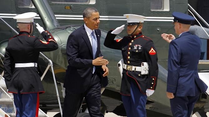 Air Force Col. Bill Knight, right, greets President Barack Obama at Andrews Air Force Base, Md., Monday, May 13, 2013, before Obama boarded Air Force One before departing to New York City for private fundraisers. (AP Photo/Ann Heisenfelt)