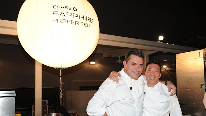 IMAGE DISTRIBUTED FOR CHASE SAPPHIRE - Chef Todd English, left, and chef Akira Back participate in the Chase Sapphire Preferred Grill Challenge during Vegas Uncork'd by Bon Appetit, at the Bellagio on Saturday, May 11, 2013 in Las Vegas. (Photo by Evan Agostini/Invision for Chase Sapphire/AP)