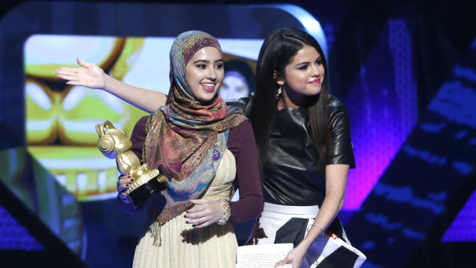 Misha Ahmad and Selena Gomez onstage during the Radio Disney Music Awards at the Nokia Theatre on Saturday, April 27, 2013 in Los Angeles. (Photo by Todd Williamson /Invision/AP)