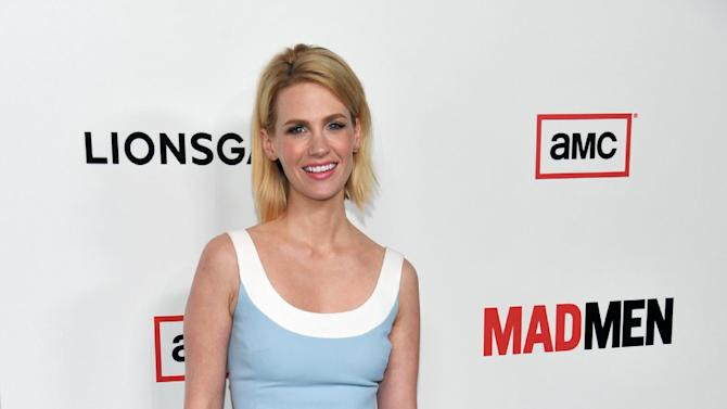 """FILE - In this Wed., March 20, 2013 file photo, January Jones, a cast member in """"Mad Men,"""" poses at the season six premiere of the drama series at the Directors Guild of America, in Los Angeles. Jones, known for her daring red carpet looks, has topped many a best and worst-dressed list. The 35-year-old Hollywood mom says she could care less about what critics think of her style. (Photo by Chris Pizzello/Invision/AP, File)"""