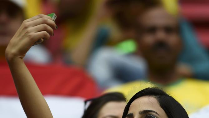 A fan takes a selfie before the 2014 World Cup round of 16 game between France and Nigeria at the Brasilia national stadium in Brasilia