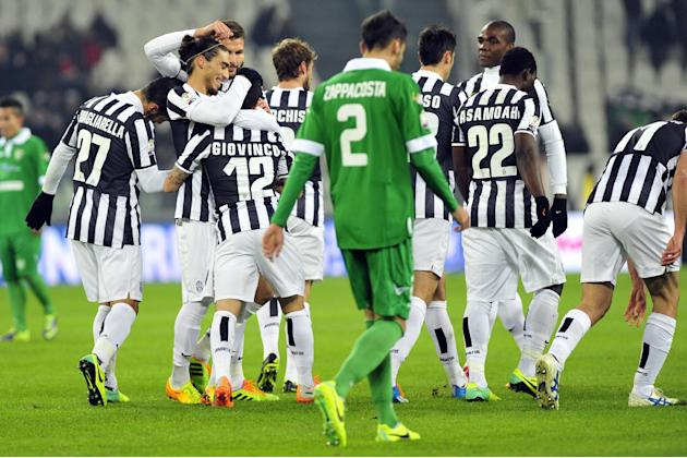 Juventus forward Sebastian Giovinco, back to camera, celebrates with teammates after scoring during an Italian Cup soccer match between Juventus and Avellino at the Juventus stadium, in Turin, Italy,