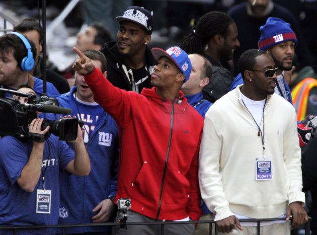 New York Giants' Victor Cruz, center, points to fans during the team's NFL football Super Bowl parade in New York, Tuesday, Feb. 7, 2012. The Giants returned from their Super Bowl win to a celebration
