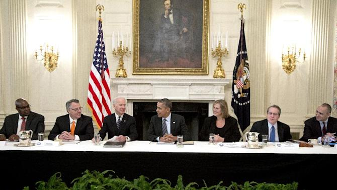 From left, Don Thompson, President and CEO, McDonald's Corporation, Greg Brown, Chairman and CEO, Motorola Solutions, Inc., Vice President Joe Biden, President Barack Obama Anne Zimmerman, President, Zimmerman & Co., CPAs, Inc. & Zimcom Internet Solutions, Gene Sperling, and Joe Echevarria, CEO, Deloitte LLP, gather in the State Dining Room of the White House, Friday, Jan. 31, 2014, in Washington., to discuss practices for hiring the long-term unemployed. (AP Photo/Carolyn Kaster)