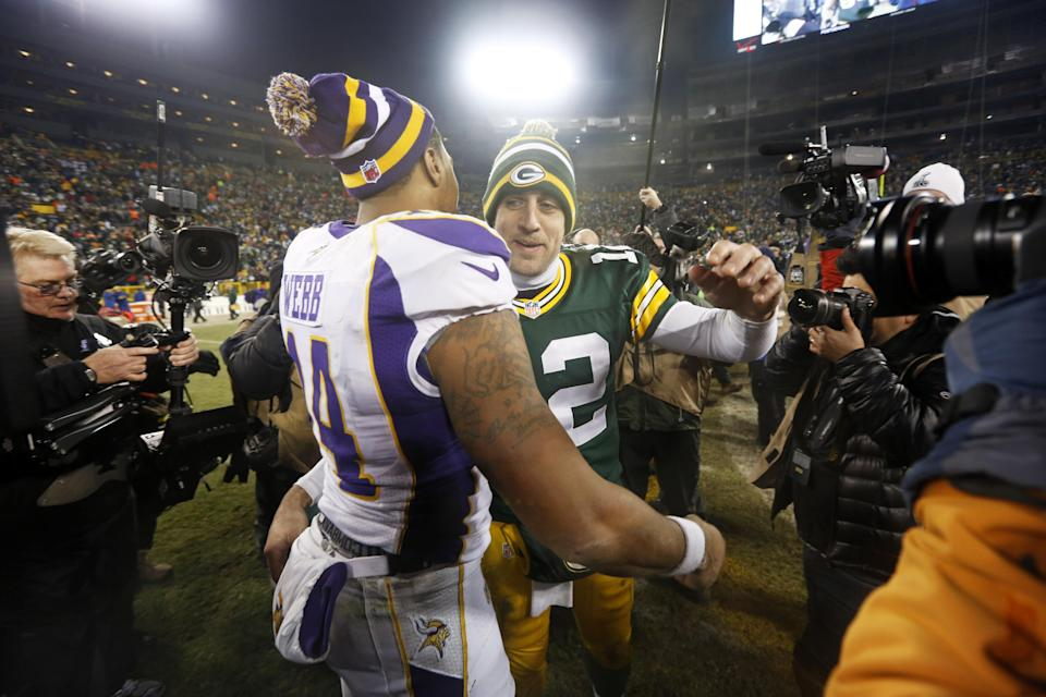 Green Bay Packers quarterback Aaron Rodgers (12) hugs Minnesota Vikings quarterback Joe Webb (14) after  an NFL wild card playoff football game Saturday, Jan. 5, 2013, in Green Bay, Wis. Packers won 24-10. (AP Photo/Mike Roemer)