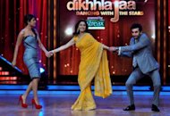 "Indian Bollywood actors Priyanka Chopra (left) and Ranbir Kapoor (right) pull on the arms of celebrity Madhuri Dixit during a promotion for their new film ""Barfi"" in Mumbai on September 12. The film, India's entry for best foreign language film at next year's Oscars, has become the latest Bollywood movie to draw flak for allegedly plagiarising foreign hits in a 'mash-up' of ripped-off scenes"