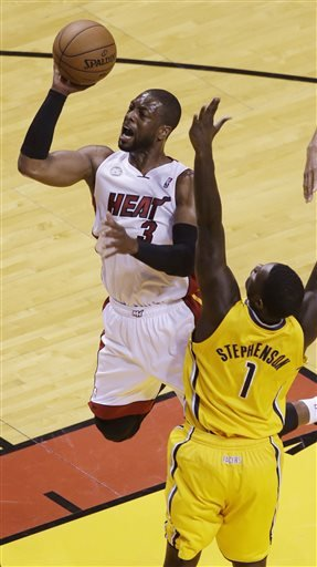 Miami Heat guard Dwyane Wade (3) drives to the basket as Indiana Pacers guard Lance Stephenson (1) defends during the first half of Game 2 in their NBA basketball Eastern Conference finals playoff ser