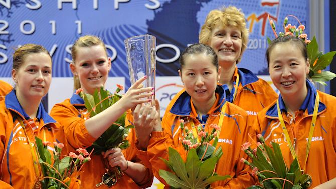 The Netherlands women's team, from left  Linda Creemers , Britt Eerland , Chen Zhibin , Li Jie , Elena Timina  and  Li Jiao present their trophy after winning the team event in the European Table Tennis Championships in Gdansk, Poland, Wednesday, Oct. 12, 2011.  (AP Photo / Wojtek Figurski) POLAND OUT