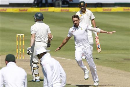 South Africa's Steyn celebrates after taking the wicket of Australia's Rogers on the first day of their third cricket test match against South Africa in Cape Town