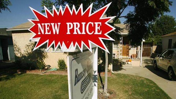 A real estate sign stands outside a three-bedroom and one-bath home in Burbank