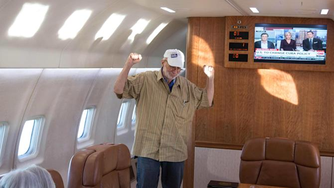 Alan Gross celebrates onboard a government plane headed back to the US with his wife, Judy Gross in this White House handout photo