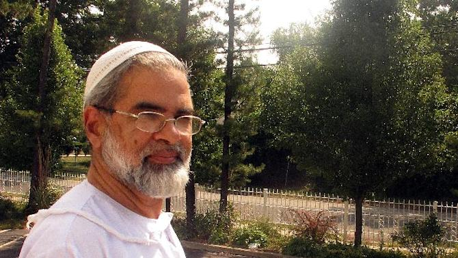 """In this July 10, 2013, photo, Imam Abdul Jabbar of the Majid Darul Quaran, also known as """"The Muslim Center of Long Island,"""" speaks about the arrest of an 18-year-old member of the mosque on terrorism charges during an interview in Bay Shore, N.Y. He says Justin Kaliebe appeared to have psychological issues, and Kaliebe's attorney contends his client was diagnosed as a child with autism. (AP Photo/Frank Eltman)"""